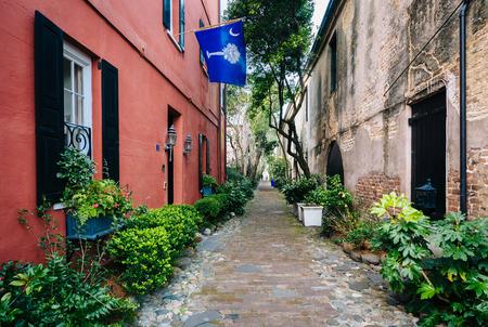 Narrow cobblestone street and old buildings in Charleston, South Carolina.