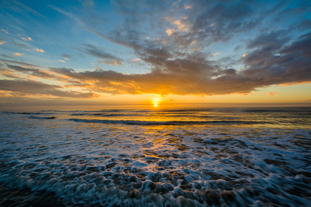 Waves in the Atlantic Ocean and sunrise, in Isle of Palms, South Carolina. Stock Photo