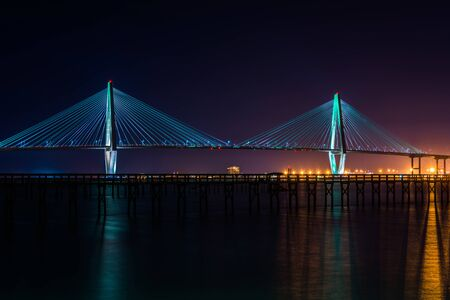 The Arthur Ravenel Bridge, over the Cooper River at night, in Charleston, South Carolina.