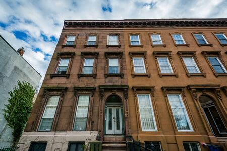 rowhouses: Rowhouses at Franklin Square, in Baltimore, Maryland. Stock Photo