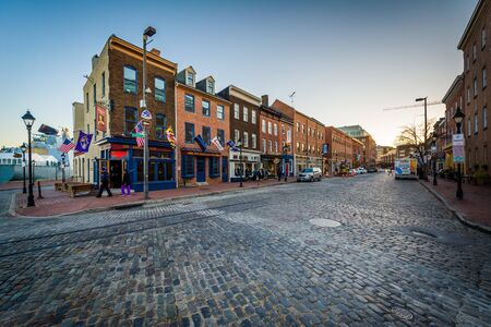Thames Street, a cobblestone street in Fells Point, Baltimore, Maryland. Editorial