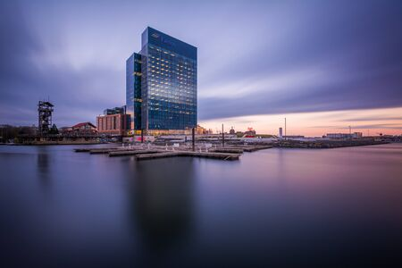 The Exelon Building at sunset, in Harbor East, Baltimore, Maryland.
