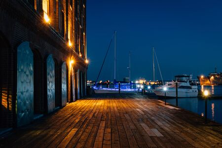 The Waterfront Promenade and Hendersons Wharf at night in Fells Point, Baltimore, Maryland.