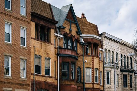 Architectural details of row houses in the Station North Arts and Entertainment District, in Baltimore, Maryland. Stock Photo