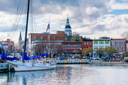Boat in Annapolis Harbor and the Maryland State House in Annapolis, Maryland.