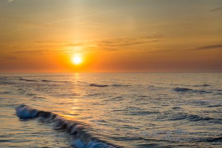 Sunrise over waves in the Atlantic Ocean in Ventnor City, New Jersey.