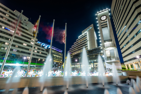 Fountains and modern buildings at night, in downtown Bethesda, Maryland.