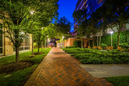 Walkway and park at night, in Bethesda, Maryland.