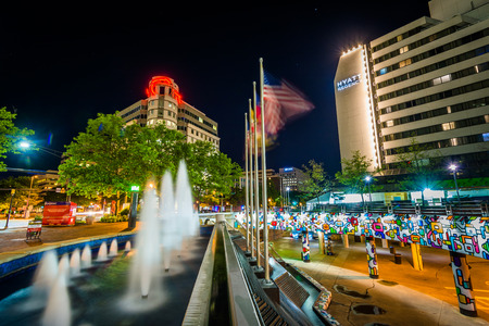 Fountains and modern buildings at night, in downtown Bethesda, Maryland. Editorial