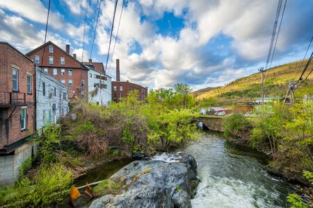 Cascades and old buildings along Whetstone Brook, in Brattleboro, Vermont. Stock Photo