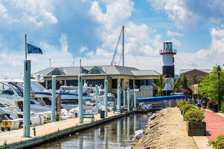maryland: The Waterfront Promenade, a marina and lighthouse in Canton, Baltimore, Maryland. Stock Photo