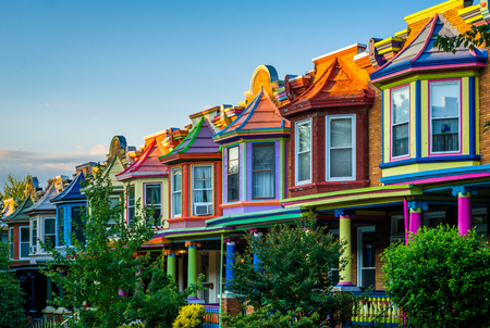 Colorful row houses on Guilford Avenue, in Charles Village, Baltimore, Maryland.