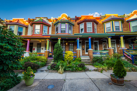 maryland: Colorful row houses on Guilford Avenue, in Charles Village, Baltimore, Maryland.