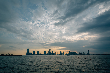 A sunset view of Jersey City, from Battery Park City in Manhattan, New York City.