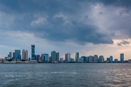 A view of the Jersey City skyline from Battery Park City, in Lower Manhattan, New York City Stock Photo