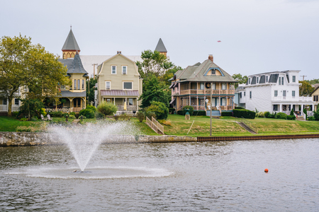Fountain and houses along Wesley Lake, in Asbury Park, New Jersey.