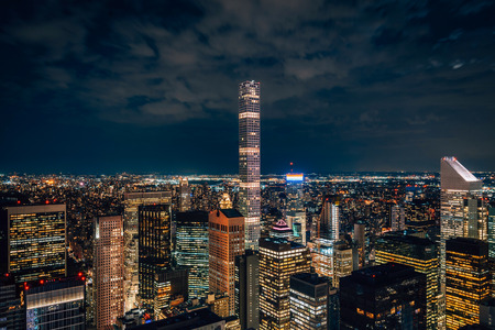 View of the Midtown Manhattan skyline at night, in New York City