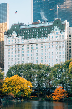 Autumn color along The Pond and the Plaza Hotel in Midtown Manhattan, New York City
