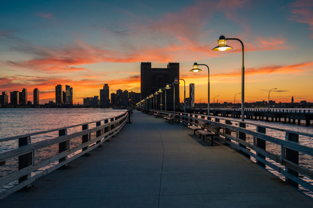 Sunset over Pier 34 and Jersey City, in Manhattan, New York City