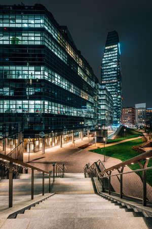 Modern buildings along Promenade Varesine at night, in Milan, Italy 免版税图像