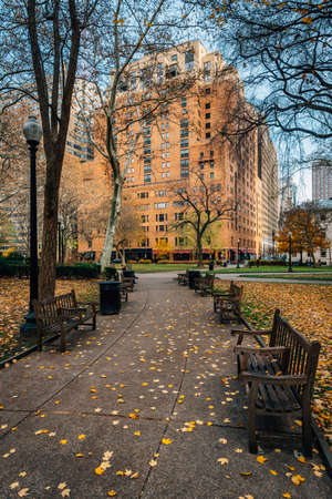 Autumn color and walkway at Rittenhouse Square Park, in Philadelphia, Pennsylvania.