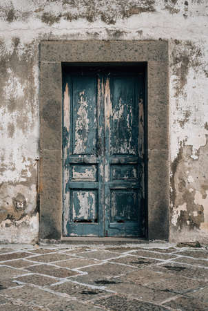 A rustic door at Castel Sant'Elmo, in Naples, Italy