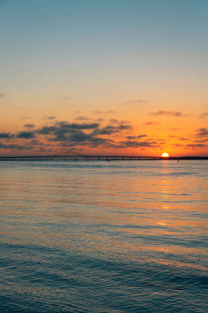 Sunset over the Robert Moses Causeway from Fire Island, New York