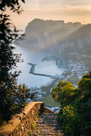 Staircase and view of Marina Grande at sunrise, in Capri, Italy