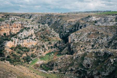 View of the Torrente Gravina canyon, in Matera, Basilicata, Italy