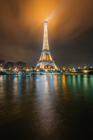 The Eiffel Tower and Seine at night, in Paris, France