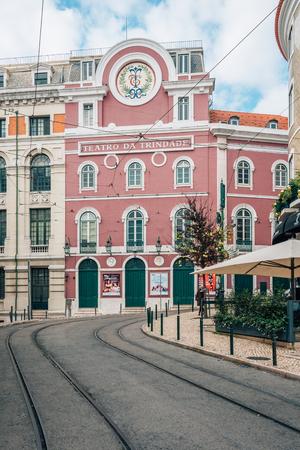 Tram tracks and the Teatro da Trindade, in Lisbon, Portugal