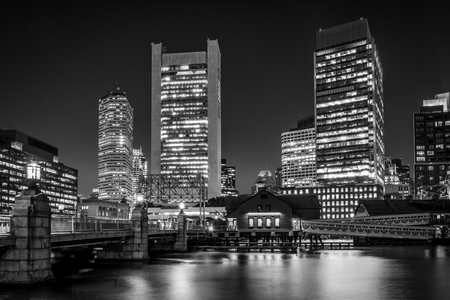 The Boston skyline and Fort Point Channel at night, in Boston, Massachusetts.