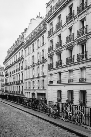 Bikes and buildings along Rue Malebranche, in Paris, France Stok Fotoğraf