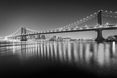 The Manhattan Bridge at night, seen from Brooklyn Bridge Park, in Brooklyn, New York.