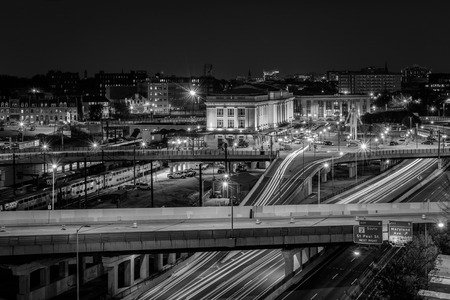 View of Penn Station and the Jones Falls Expressway at night, in Midtown Baltimore, Maryland. Reklamní fotografie