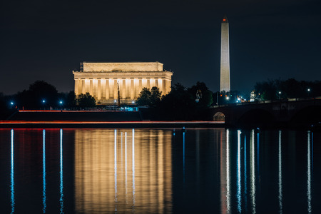 The Lincoln Memorial and Washington Monument reflecting in the Potomac River, in Washington, DC