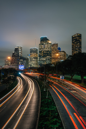 Long exposure of traffic on Allen Parkway and the Houston skyline at night, in Houston, Texas Stok Fotoğraf