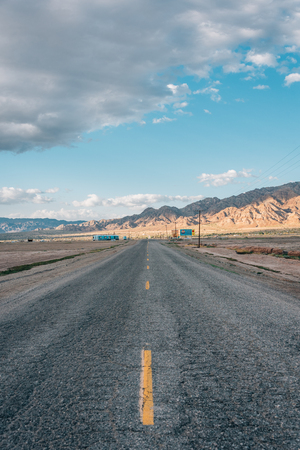 Road and mountains in the desert near Niland, California Stock Photo