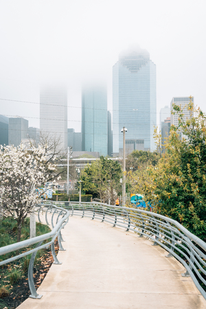 View of the Houston skyline in fog, from Buffalo Bayou Park in Houston, Texas