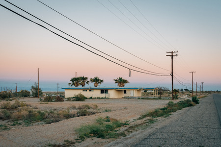 Abandoned house and street at sunset, in Salton City, California