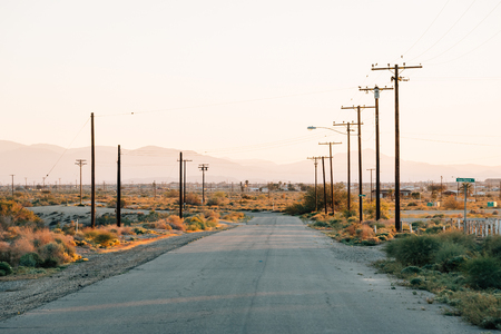 A street at sunset, in the abandoned town of Salton City, California Stock Photo