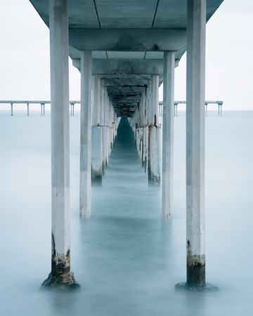 Long exposure under the Ocean Beach Pier in San Diego, California