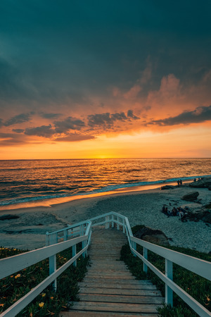 Vibrant sunset over a staircase and the Pacific Ocean at Windansea Beach, in La Jolla, San Diego, California