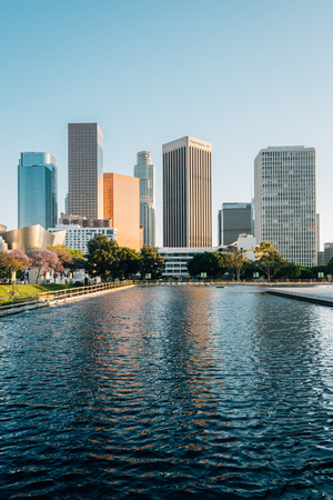 The downtown Los Angeles skyline, with the reflecting pool at the Department of Water and Power, in Los Angeles, California Imagens