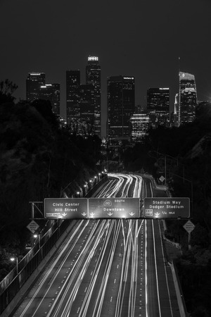 View of the downtown Los Angeles skyline and 110 Freeway at night, from Elysian Park in Los Angeles, California Editorial