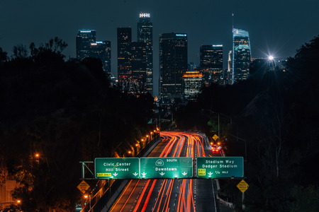 View of the downtown Los Angeles skyline and 110 Freeway at night, from Elysian Park in Los Angeles, California