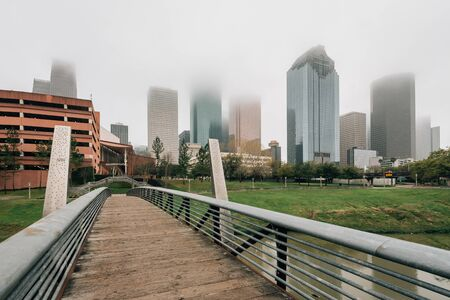 Bridge and view of the downtown skyline in fog, in Houston, Texas