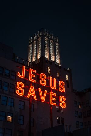 Jesus Saves sign at night, in downtown Los Angeles, California