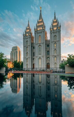 Reflections of the Salt Lake LDS Temple at sunset, in Temple Square, in Salt Lake City, Utah Stock Photo