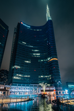 The UniCredit Tower at night, at Piazza Gae Aulenti, in Milan, Italy